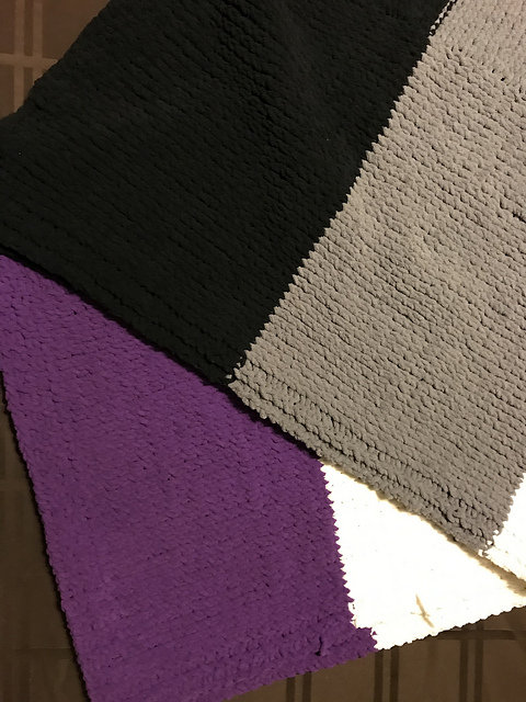 black, gray, white and purple blanket