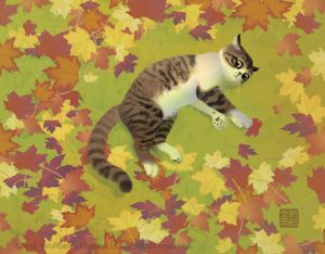 cat lying on grass, surrounded by fall leaves