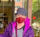 Person wearing red face mask and pink collar
