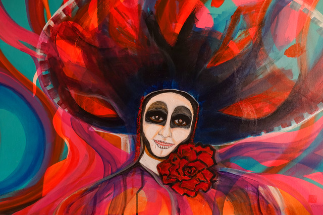 Painting of person with skull makeup, wide colorful hat and red shirt