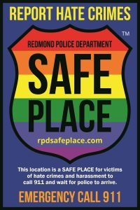"""rainbow badge with text """"report hate crimes"""""""